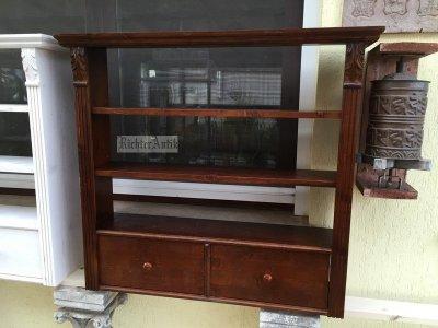 Antik bútor, dió színű fiókos falipolc.
